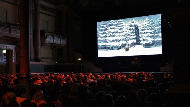 Full cinema of young people watching The Gruffalo's Child