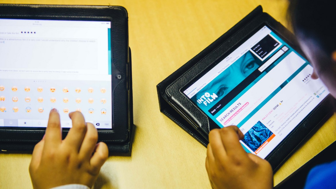 Young people using iPads