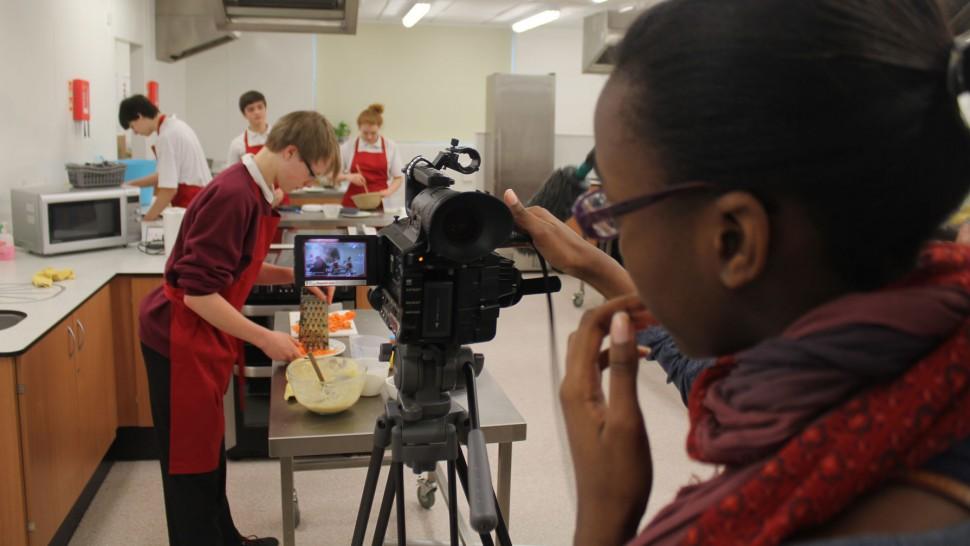 Secondary students using filmmaking equipment
